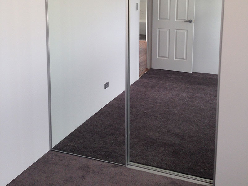 Mirror sliding robe doors